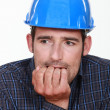 Nervous man wearing a hardhat — Stock Photo