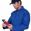 Tradesman adjusting a pipe wrench — Stock Photo