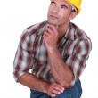 Tradesman with a dreamy look on his face — Stock Photo #9786069