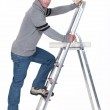 Man putting up wallpaper — Stock Photo #9786101