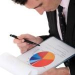 Man interpreting graph — Stock Photo