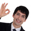 A businessman gesturing an ok sign. — Stock Photo #9787535