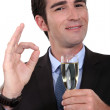 Businessman having a glass of champagne — Stock Photo