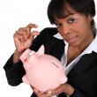 Black businesswoman with piggybank — Stock Photo