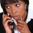 Concerned businesswoman taking phone call — Stock Photo #9788253