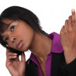 Afro-American businesswoman talking on her cell — Stock Photo