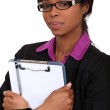Businesswoman holding clipboard — Stock Photo #9788510