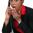 Stock Photo: Surprised womon telephone