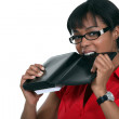 Woman biting her personal organizer — Stock Photo #9788578