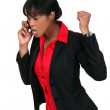 An angry businesswoman over the phone. — Stock Photo