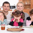 Sulky children with pancakes — Stock Photo