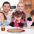 Stock Photo: Sulky children with pancakes