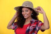 Cheerful brunette wearing straw hat — Stock Photo