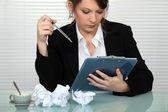 Businesswoman struggling to write presentation — Stock Photo