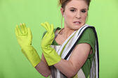 Disgusted house cleaner — Stock Photo