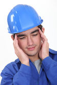 Builder suffering from tension headache — Stock Photo