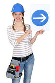Woman with a one way sign — Stock Photo