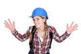 Tradeswoman holding up her hands — Stock Photo