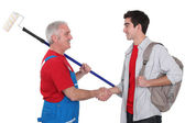 Experienced tradesman welcoming his new recruit — Foto Stock