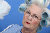 Granny with her hair in rollers — Stock Photo