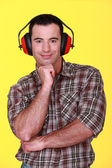 Man wearing ear defenders — Stock Photo