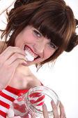 A woman eating marshmallows. — Stock Photo