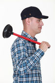 Plumber with a plunger — Stock Photo