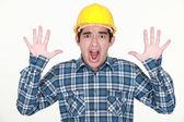 A frightened tradesman — Stock Photo
