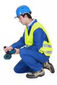 Contractor using angle grinder — Stock Photo