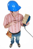 High angle shot of young carpenter holding sander machine — Stock Photo