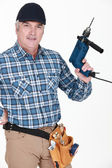 Man holding a power tool — Stockfoto