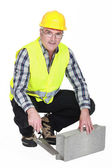Bricklayer in a reflective vest — Stock Photo