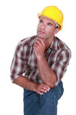 Tradesman with a dreamy look on his face — Stock Photo