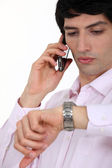 Businessman checking the time during call — Stock Photo