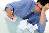 A businessman writing. — Stock Photo