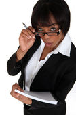 Businesswoman with notepad and pen — Stock Photo