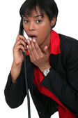 Surprised woman on the telephone — Stock Photo