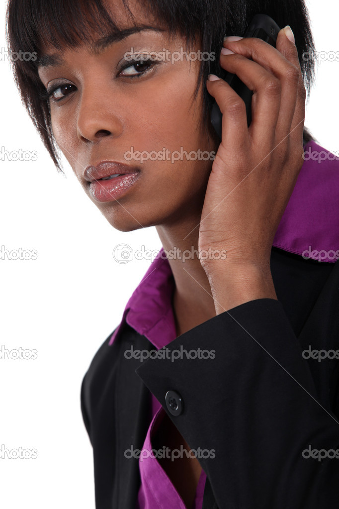 Afro-American businesswoman talking on her cell — Stock Photo #9788477