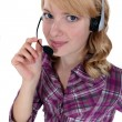 Stock Photo: Womwearing headset