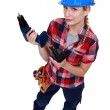 Tradeswoman holding a battery-powered power tool — Stock Photo #9807164