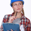 Stock Photo: Thoughtful tradeswoman