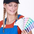Stock Photo: Womchoosing which color paint to use