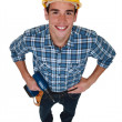 Stock Photo: Young tradesmholding power tool