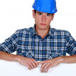 Stock Photo: Builder looking upset