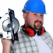 Bearded man holding circular-saw — Stock Photo