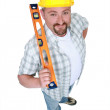 A manual worker holding a level. — Stock Photo #9808385