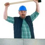 Animated builder holding sledge-hammer — Stock Photo