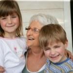 Grandmother looking after grandchildren — Stock Photo