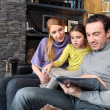 Royalty-Free Stock Photo: Happy parents reading their young daughter a story
