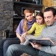 Stock Photo: Happy parents reading their young daughter story